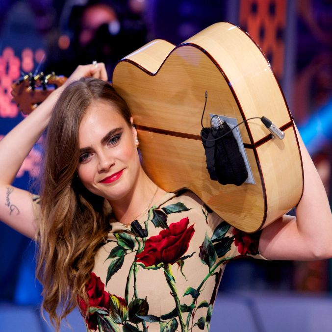 Cara Delevingne Plays Guitar Behind Her Back